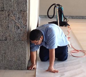 technician cleaning commercial floor