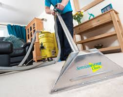 servicemaster technician cleaning carpet