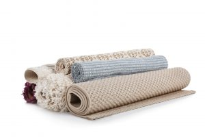 rolled up area rugs