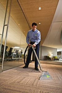 technician cleaning commercial carpet
