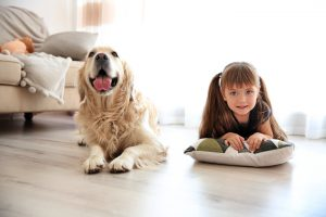 dog and young girl lying on floor