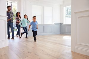 family entering new house on moving day